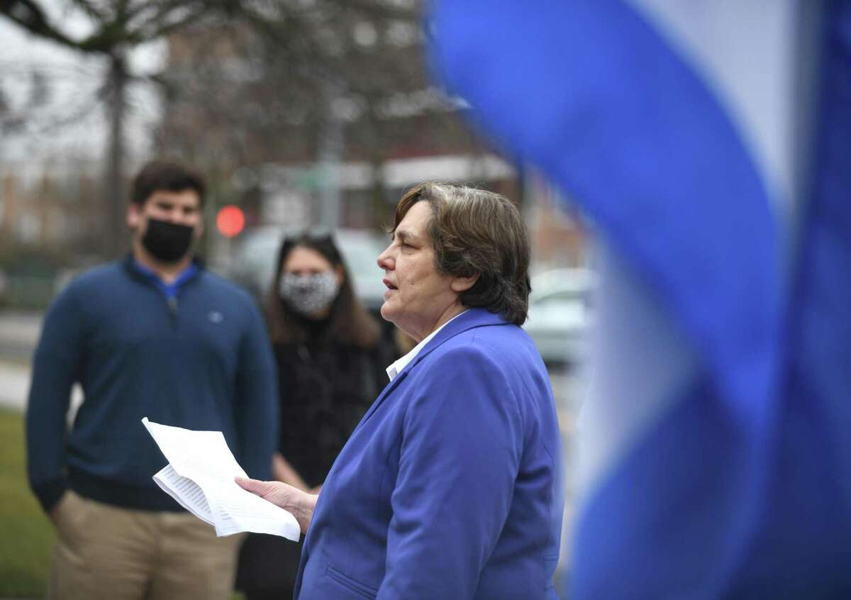 BET member Karen Fassuliotis speaks during the Greek independence day flag-raising outside Town Hall in Greenwich, Conn. Thursday, March 25, 2021. The event marked 200 years of Greek independence and was well attended by local residents of Greek heritage. BET member Karen Fassuliotis and First Selectman Fred Camillo spoke at the event.