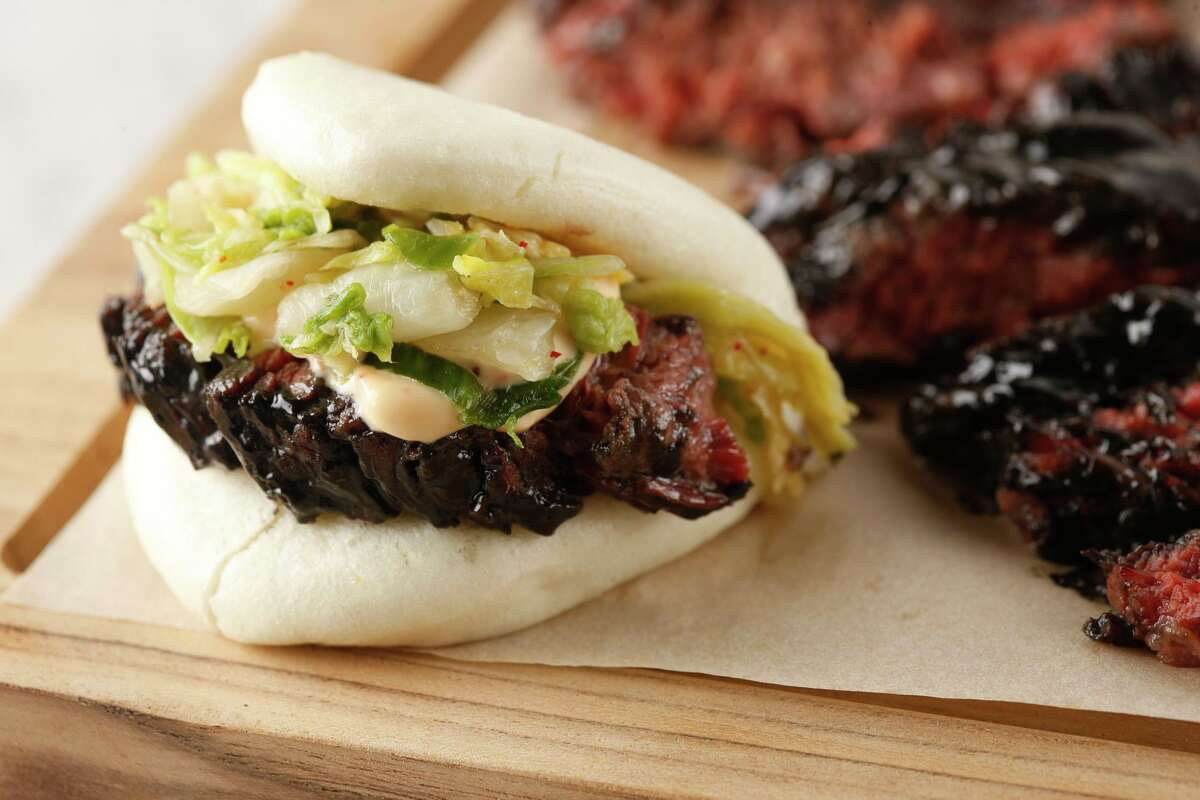 Wagyu Brisket Steam Buns served with Napa kimchi and duck fat potato tempura at The Cottage in Westport.