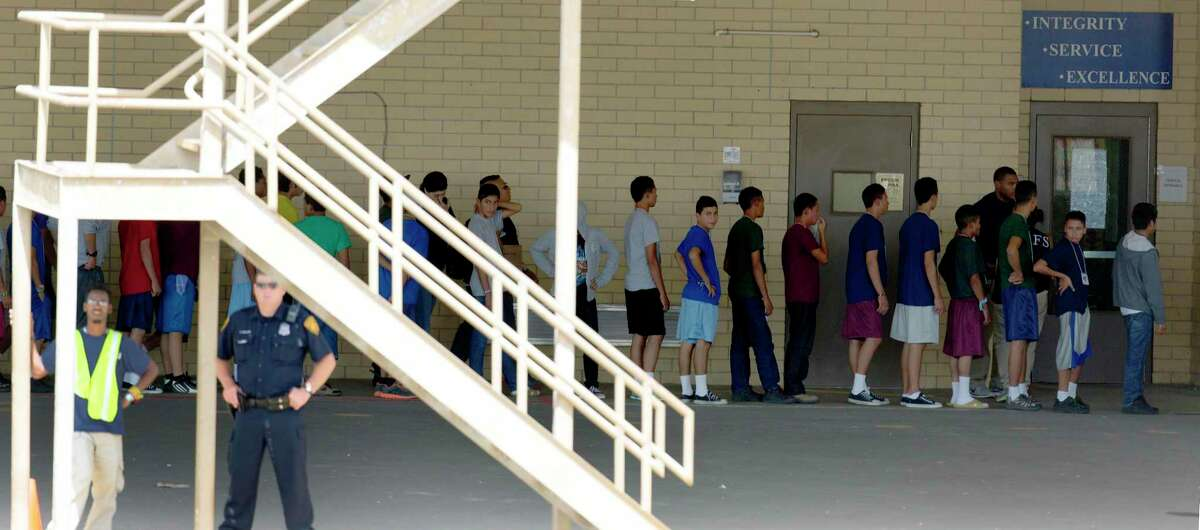 Undocumented minors are seen Wednesday July 2, 2014 in the housing area on Lackland Air Force Base where they were kept while waiting for their legal status to be resolved.