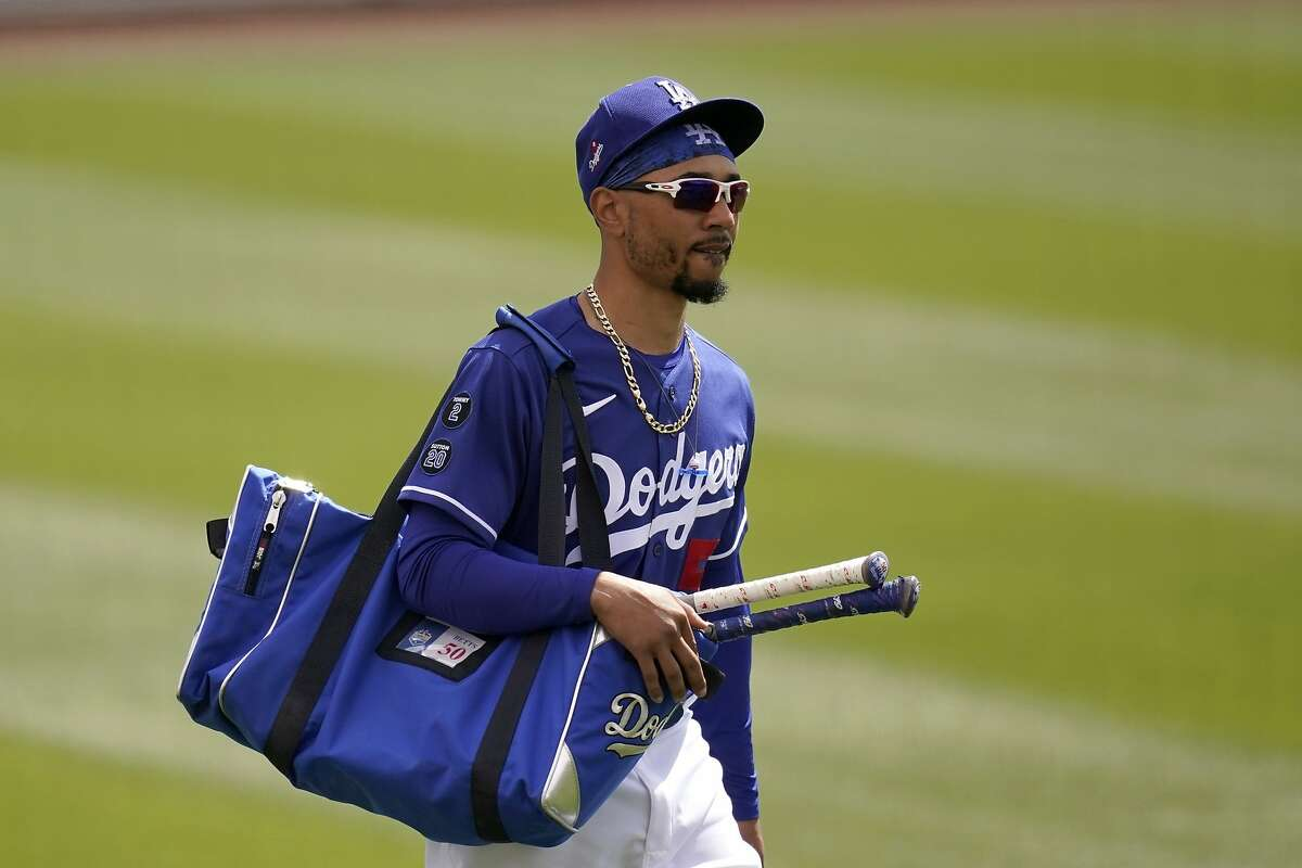 Los Angeles Dodgers' Mookie Betts walks to the dugout prior to a spring training baseball game against the Milwaukee Brewers Tuesday, March 16, 2021, in Phoenix. (AP Photo/Ross D. Franklin)