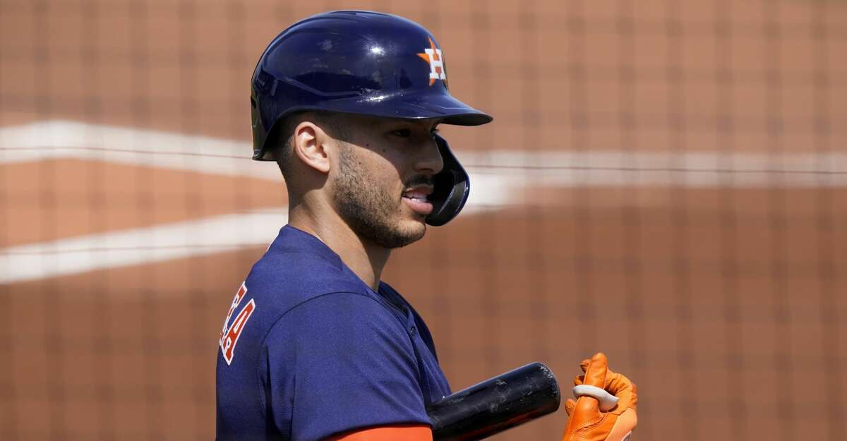 Houston Astros' Carlos Correa prepares to bat during the first inning of a spring training baseball game against the Miami Marlins, Friday, March 5, 2021, in Jupiter, Fla. (AP Photo/Lynne Sladky)