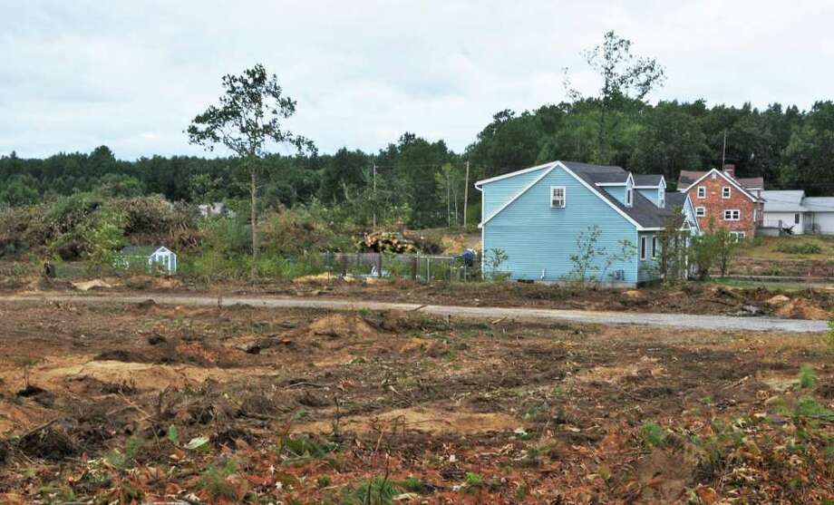 This is one of the phases of clear-cutting near homes along Rowland Street in Milton being done near the Saratoga County Airport.  (John Carl D'Annibale / Times Union) Photo: John Carl D'Annibale / 00010199A