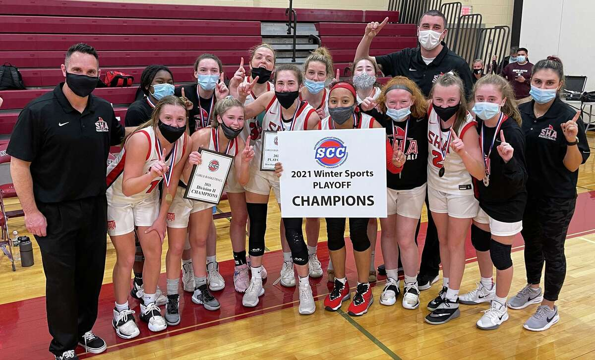Members of the Sacred Heart Academy girls basketball celebrate after beating West Haven to win the SCC Division II championship on Thursday.