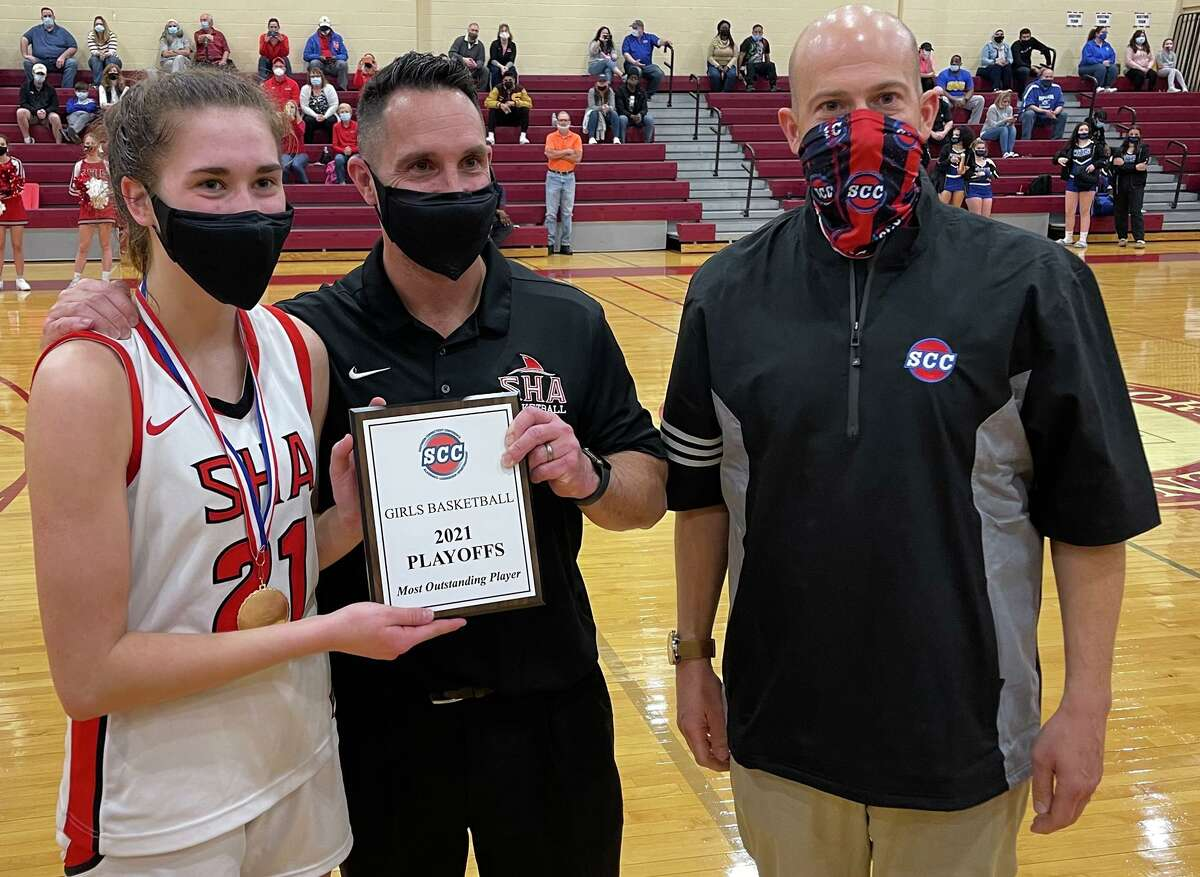 From left, Sacred Heart Academy's Rosa Rizzitelli poses with the tournament's Most Outstanding Player plaque with SHA coach Jason Kirck and SCC commissioner Al Carbone.
