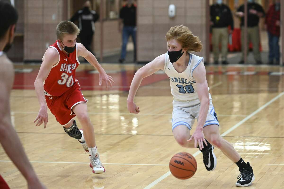 Meridian's Dane Plichta drives towards the basket during the Mustangs' district semifinal game against Beaverton March 25, 2021 at Beaverton High School. (Adam Ferman/for the Daily News)