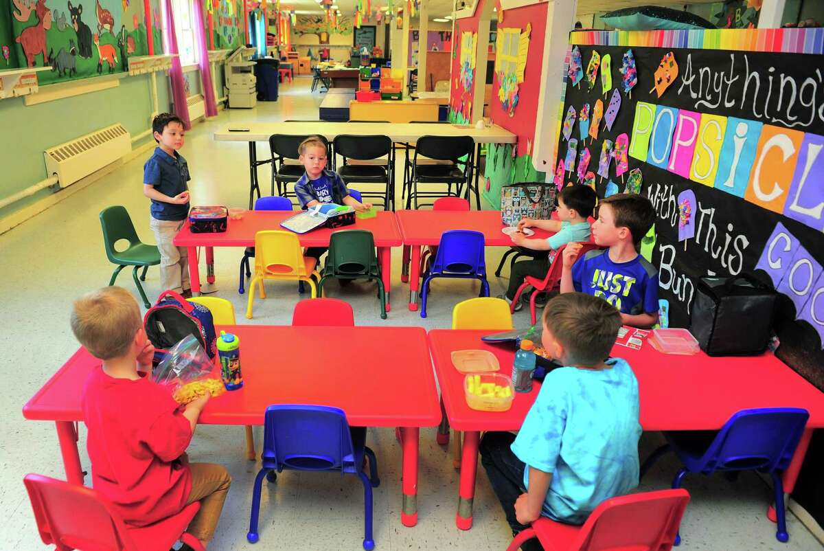 Students eat lunch at The Hideout, a preschool and child care facility in Shelton on May 15.