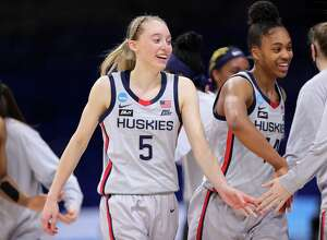 SAN ANTONIO, TEXAS - MARCH 23: Paige Bueckers #5 and Aubrey Griffin #44 of the UConn Huskies walk off the court during the second half against the Syracuse Orange in the second round game of the 2021 NCAA Women's Basketball Tournament at the Alamodome on March 23, 2021 in San Antonio, Texas. (Photo by Carmen Mandato/Getty Images)