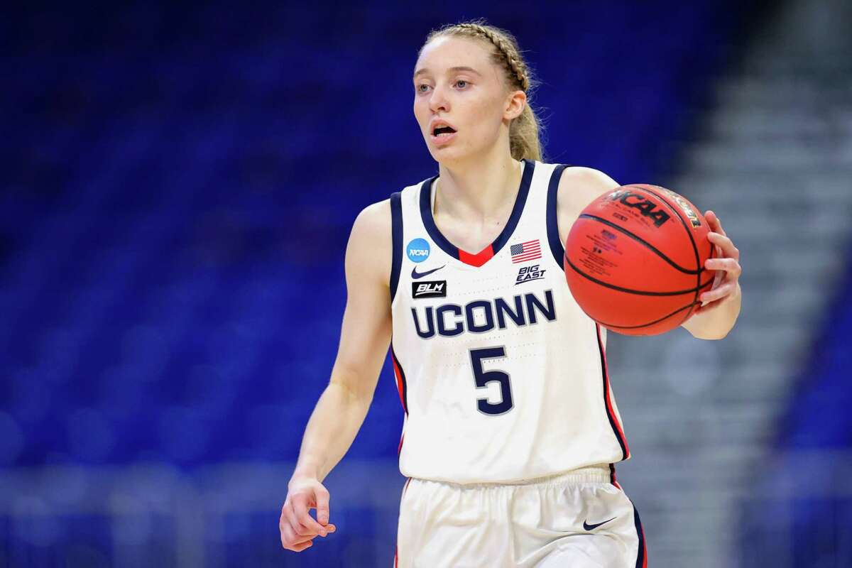 SAN ANTONIO, TEXAS - MARCH 21: Paige Bueckers #5 of the UConn Huskies controls the ball against the High Point Panthers during the first half in the first round game of the 2021 NCAA Women's Basketball Tournament at the Alamodome on March 21, 2021 in San Antonio, Texas. (Photo by Carmen Mandato/Getty Images)