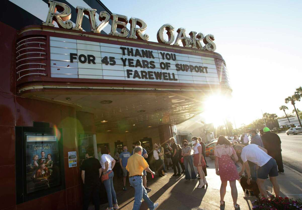 People gather at River Oaks Theatre on the final day of showing films Thursday, March 25, 2021, in Houston.