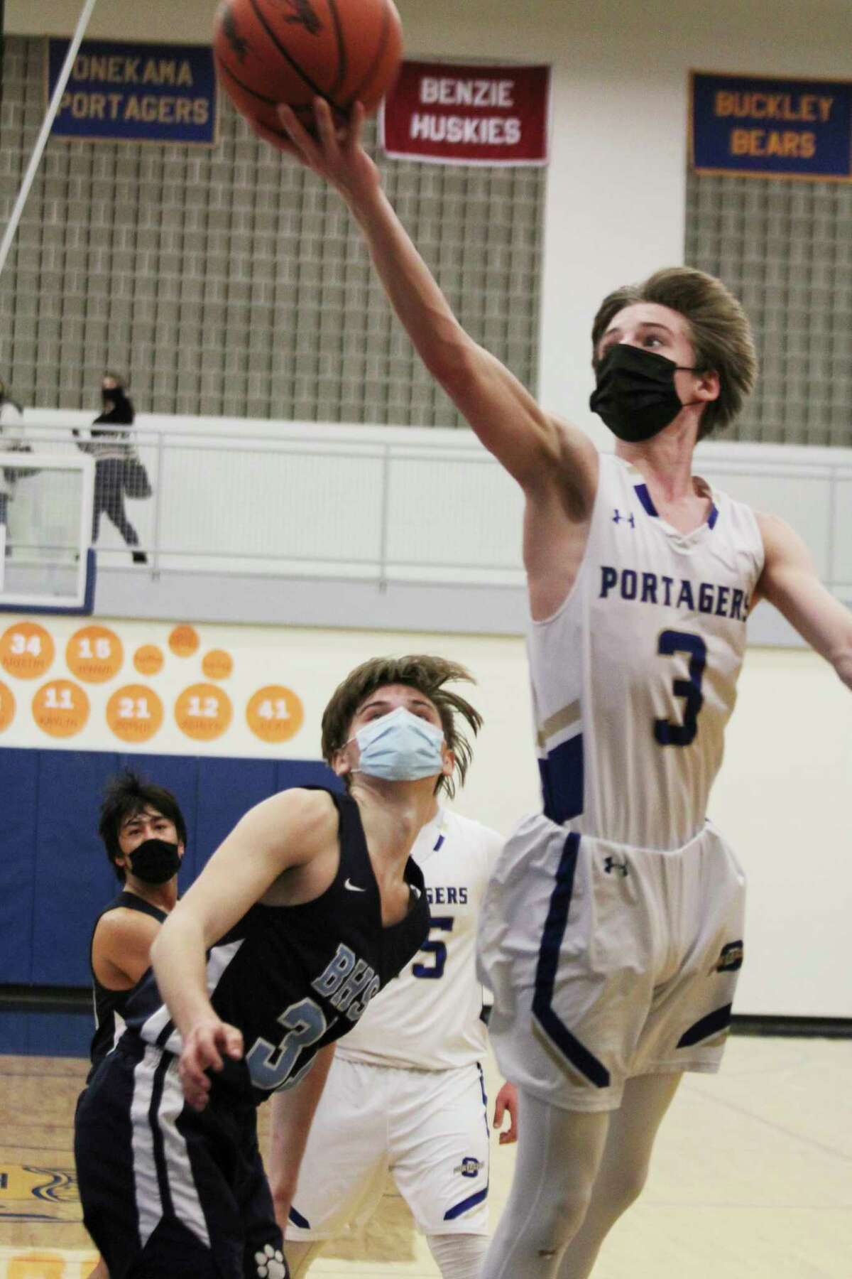 Onekama's Nate Corey eyes a layup during Thursday's district semifinal against Brethren. (Dylan Savela/News Advocate)