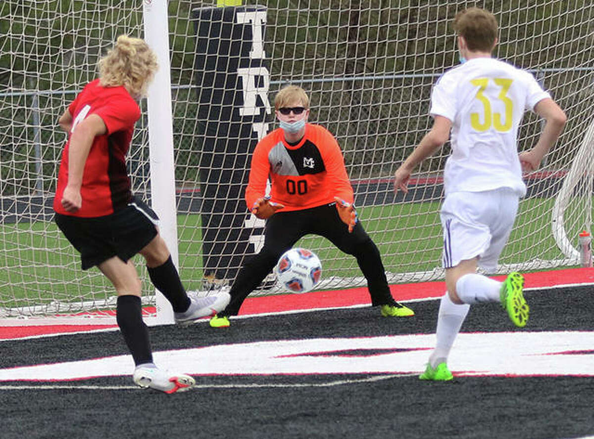 CM goalie Tommy Strubhart (middle) makes the on a shot from Triad's Jake Ellis (left) while CM's Ben Werts follows the play early in the MVC game Thursday in Troy.