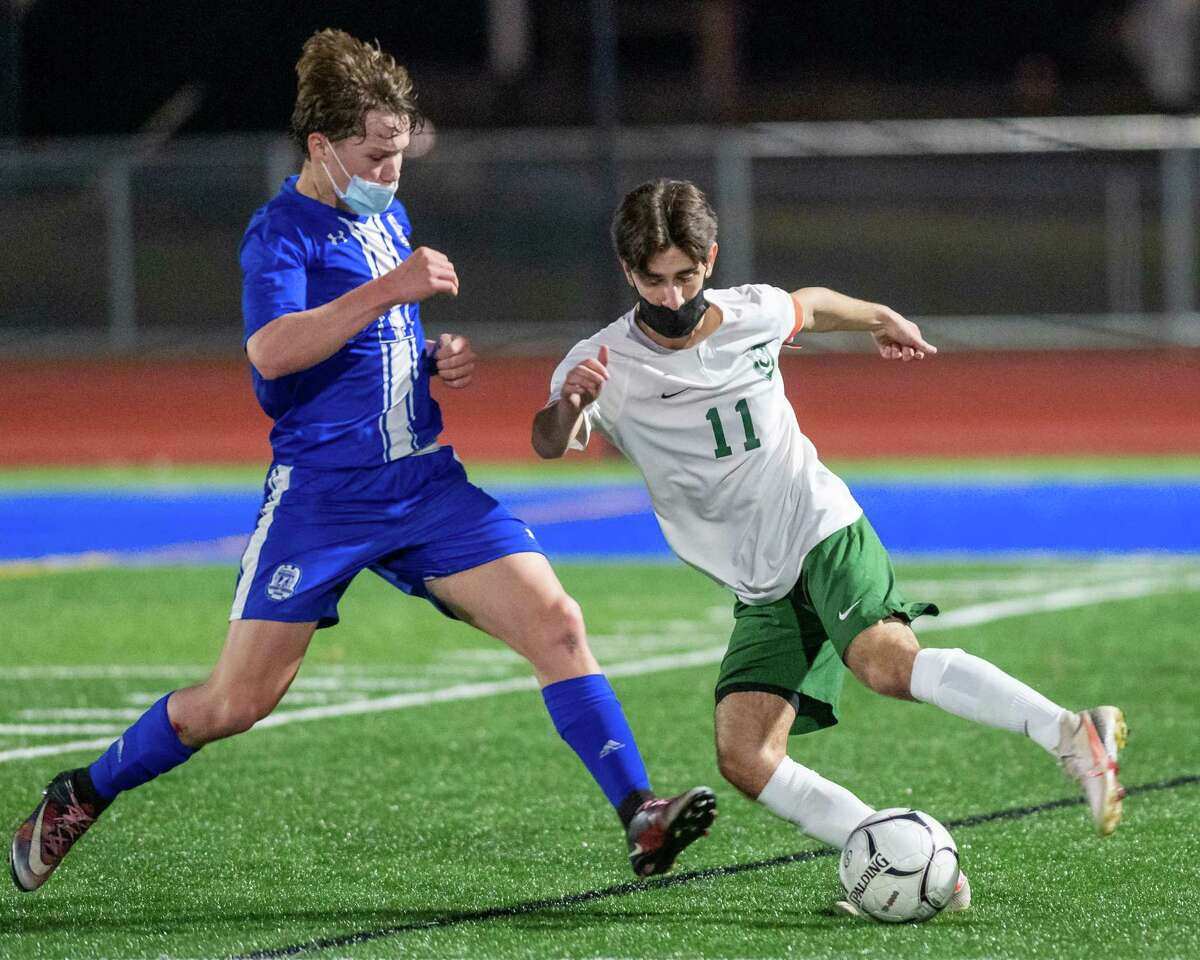 Schalmont's Sam Parisi, right, battles LaSalle sophomore Luke Micklas during their recent game. (Jim Franco/Special to the Times Union)