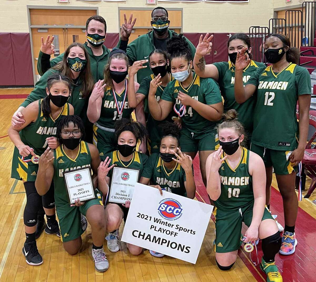 Members of the Hamden girls basketball team celebrate after beating Wilbur Cross in the SCC Division I championship game on Thursday.