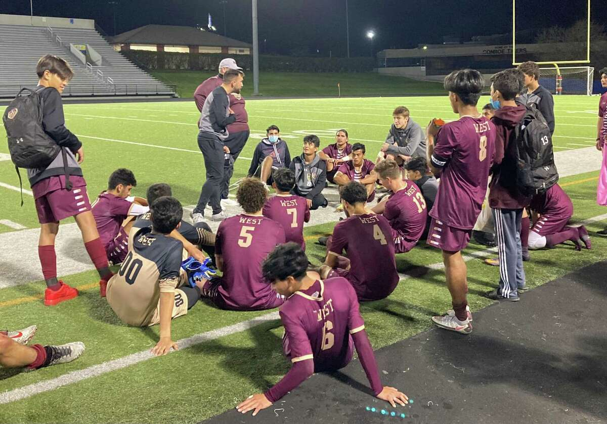 Magnolia West coach Christian Boehm speaks to his team after its 1-0 win over Caney Creek in the Region III-5A bi-district playoffs Thursday night at Buddy Moorhead Stadium in Conroe.