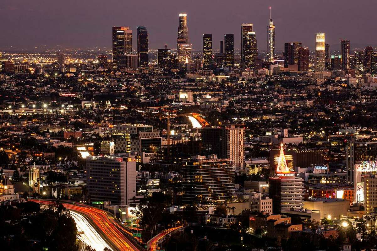 The Downtown Los Angeles skyline sits as a backdop to the Hollywood and the motorists driving up and down the 101 Freeway, seen from the Jerome C. Daniel Overlook above the Hollywood Bowl on Tuesday, Dec. 25, 2018 in Los Angeles, Calif.