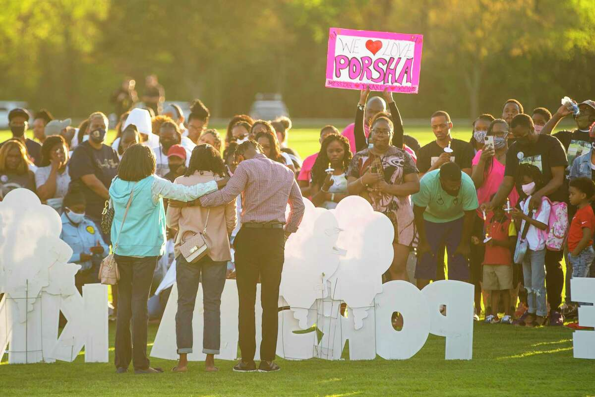 Family members speak to people gathered for a vigil for Porsha Branch and her three young children, Drake, King and Messiah, who were killed by a drunk driver earlier this month, during a balloon release at Meyer Park on Thursday evening, March 25, 2021, in Spring.
