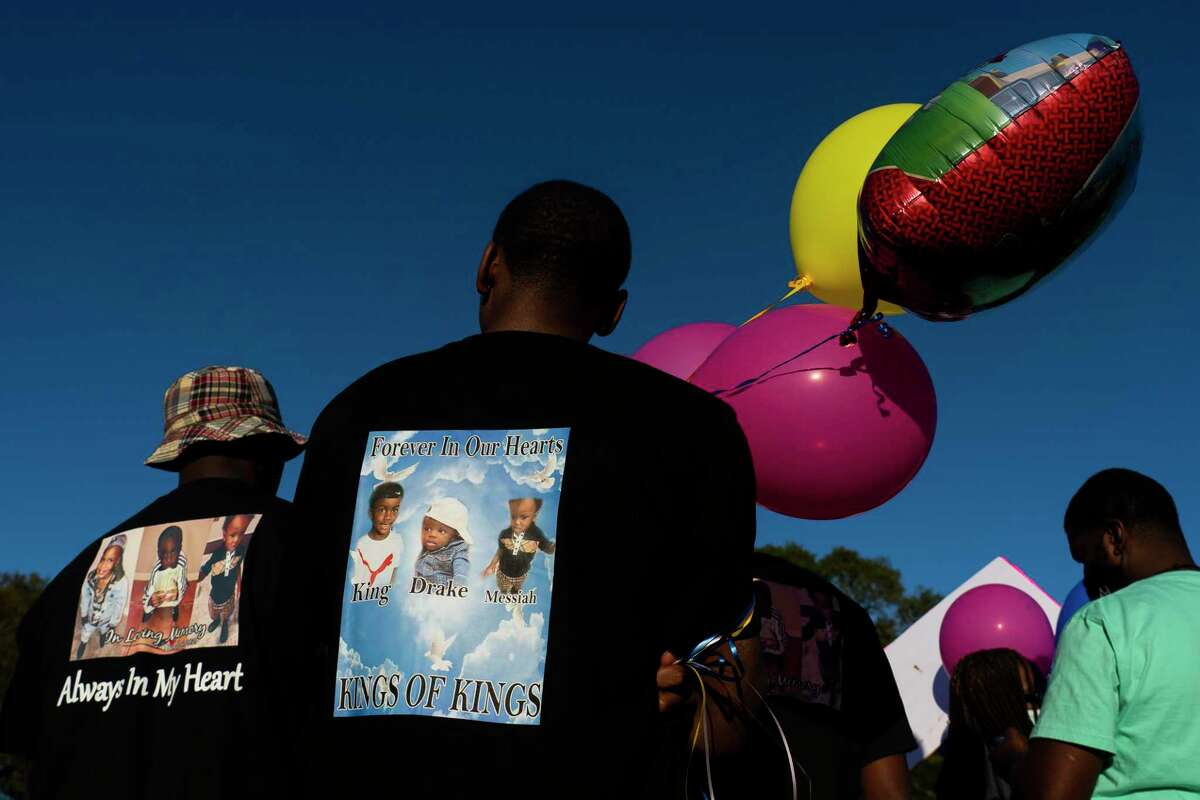 Family and friends of Porsha Branch, who was killed by a drunk driver along with her three young children, Drake, King and Messiah, hold a vigil for the family on Thursday evening, March 25, 2021, at Meyer Park in Spring.