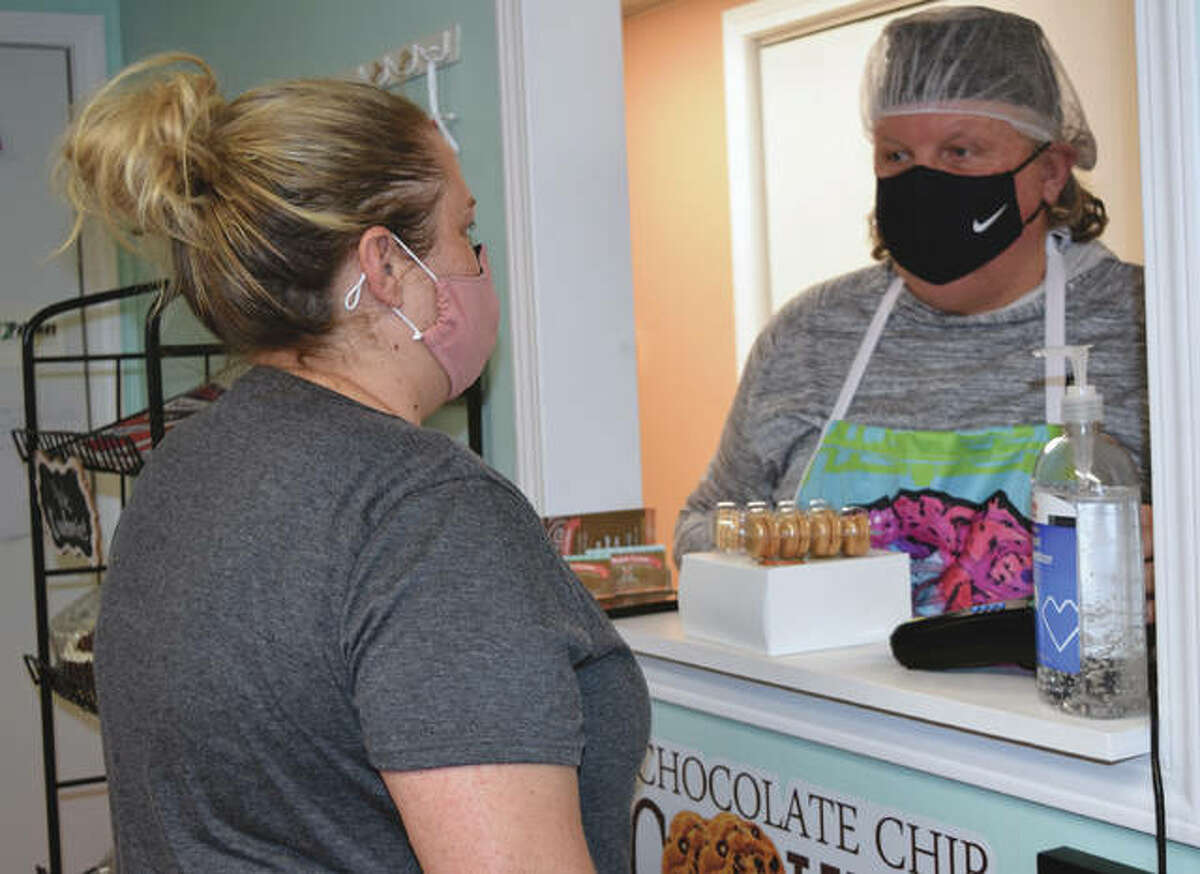 Sarah Crum of Murrayville buys a box of cookies Thursday at No Regrets Cookies in Jacksonville.