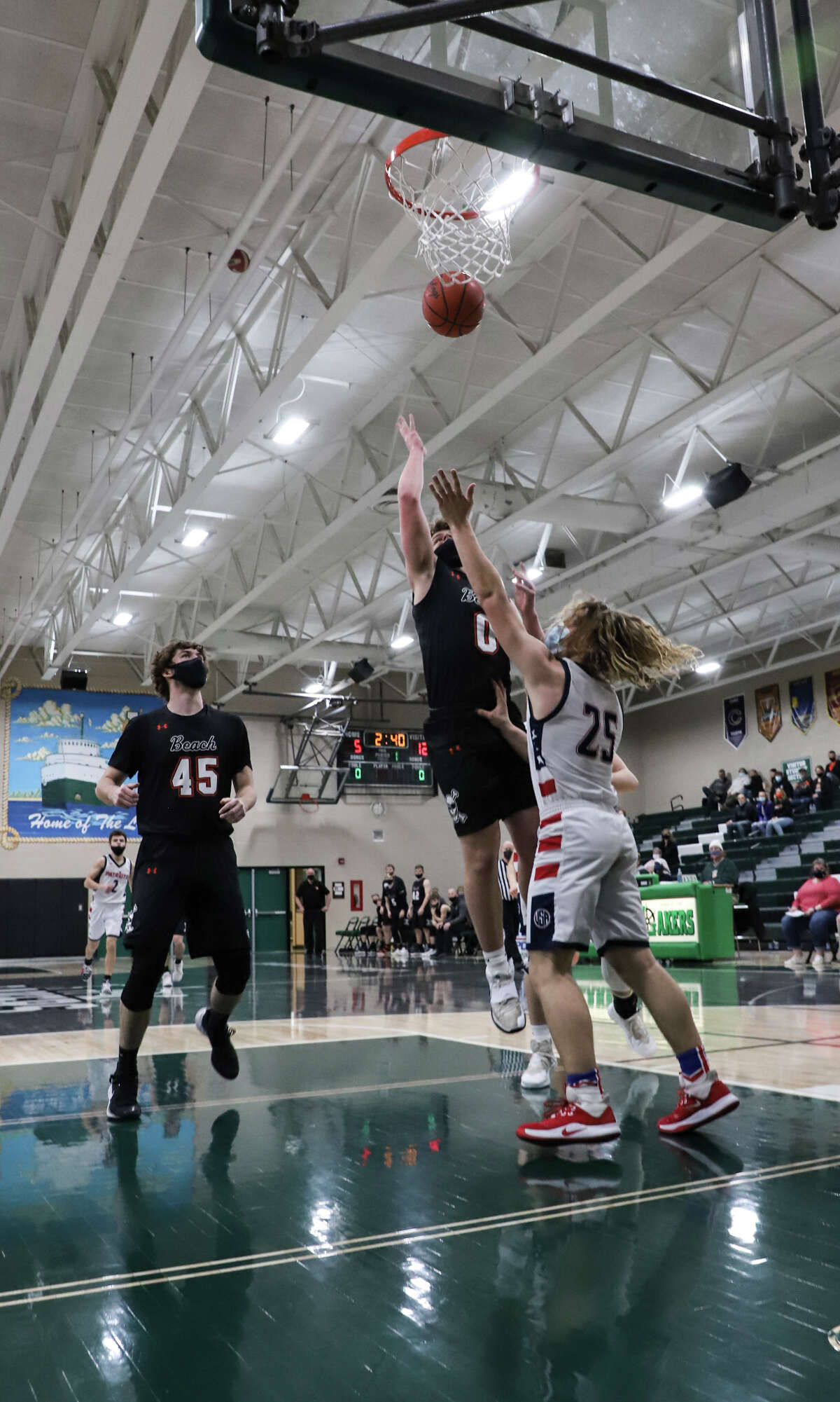 The Bad Axe boys basketball team earned a chance to play for a district championship this weekend by defeating the Cass City Red Hawks, 58-51, on Thursday night at Laker High School.