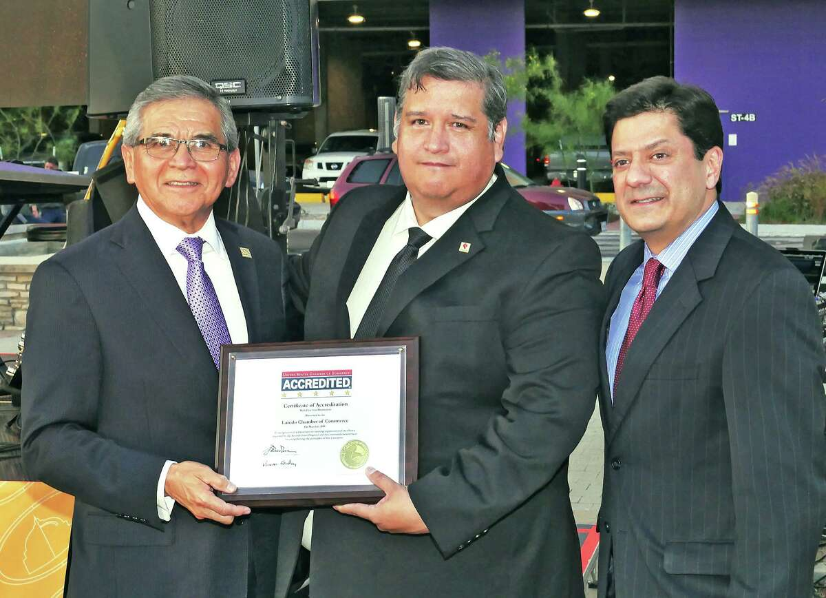 """John Gonzalez, right, regional representative for the U.S. Chamber of Commerce, presented a certificate of a 5-Star Accreditation to the Laredo Chamber of Commerce President/CEO Miguel Conchas and Chamber Board President Jose """"Pepe"""" Zuñiga Wednesday, May 9, 2018 at the El Portal Plaza."""