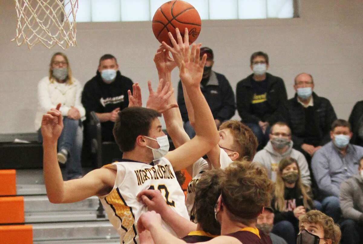 The North Huron boys basketball team fought off a tough Deckerville squad on Thursday night and earned the right to challenge the Ubly Bearcats for the district championship. The Warriors won, 46-41.