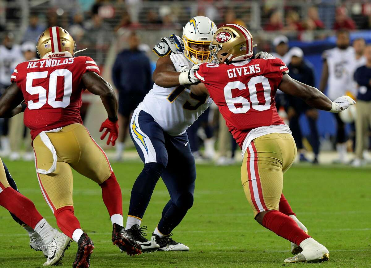 Kevin Givens (60) rushing in the second quarter during a preseason NFL game between the San Francisco 49ers and the Los Angeles Chargers at Levi's Stadium in Santa Clara, Calif., on Thursday, August 29, 2019. Givens faces an assault charge for an alleged incident that occured in Baltimore in February.