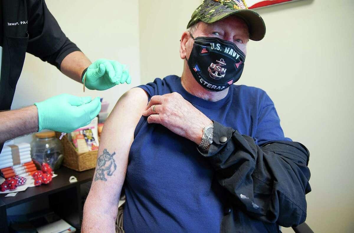 Navy Veteran Douglas Breaker of Kingwood gets his COVID-19 vaccine at the Conroe VA Clinic on Saturday, March 20, 2021.