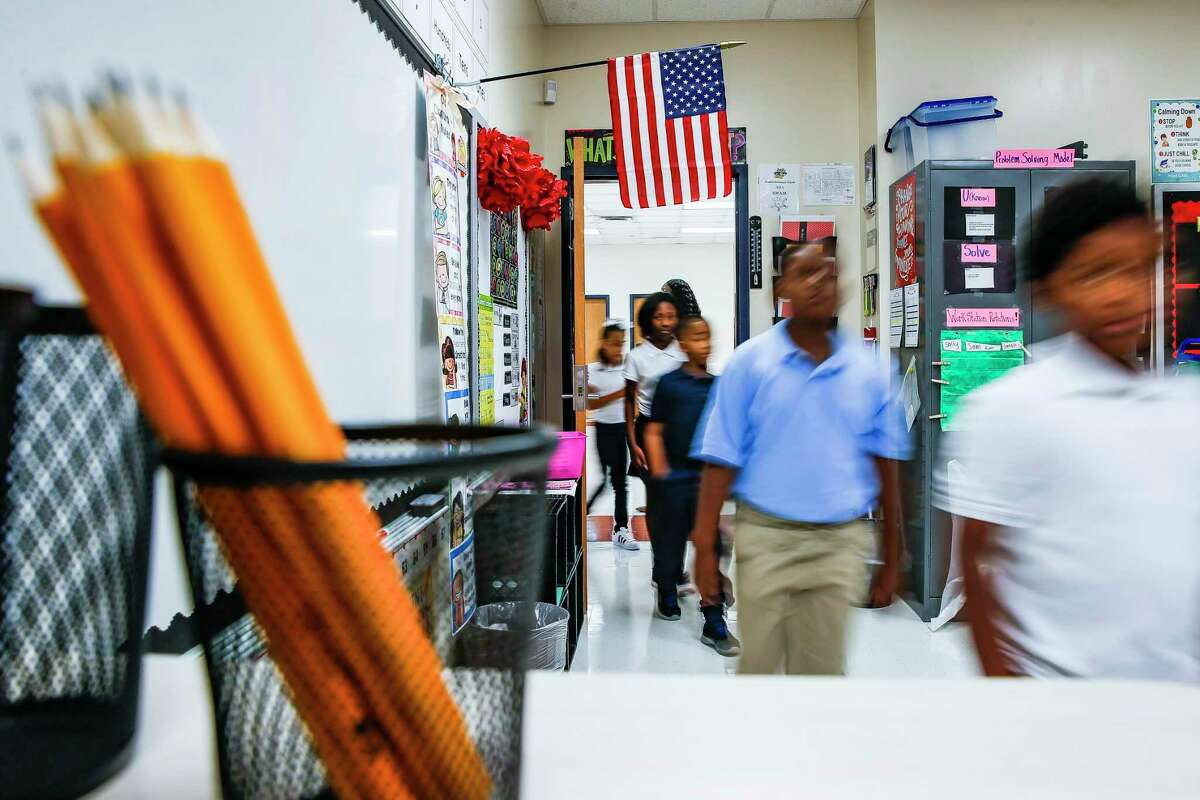 Third-grade students at Houston ISD's Hilliard Elementary School, pictured in 2018, walk into their classroom during the first day of classes. Schools such as Hilliard Elementary, which is located on the city's northeast side, likely would benefit from additional resources under recommendations from a district resource allocation committee.
