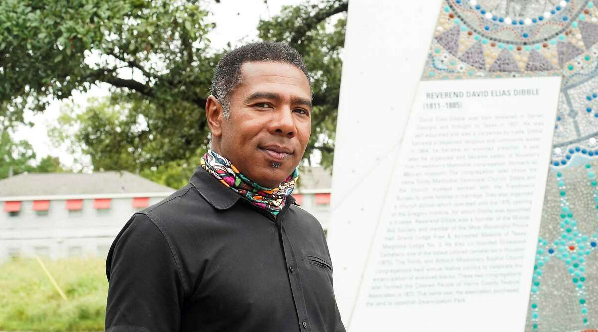 Reginald Adams stands near one of four mosaic murals he has completed on each corner of Emancipation Park in Houston on Thursday, Sept. 10, 2020. The monuments, made of mosaic panels and created with the help of community middle school students and adults, honor the four founders of the park: Jack Yates, Richard Brock, Richard Allen and Elias Dibble. Adams has been commissioned for a possible Juneteenth mural in Galveston.