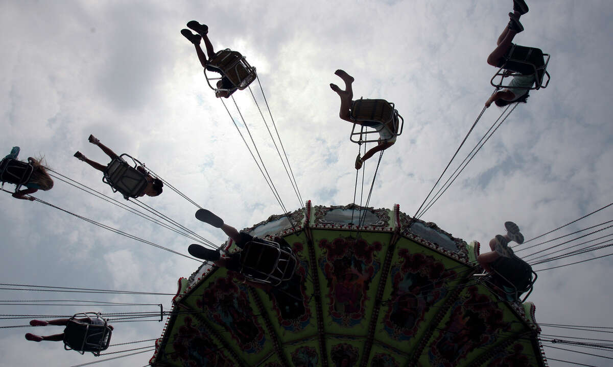 In this file photo from 2008, guests ride the Wave Swinger during the annual Cornyval Festival in Helotes. After the event was canceled in 2020 in response to the coronavirus pandemic, it is making its return next month.