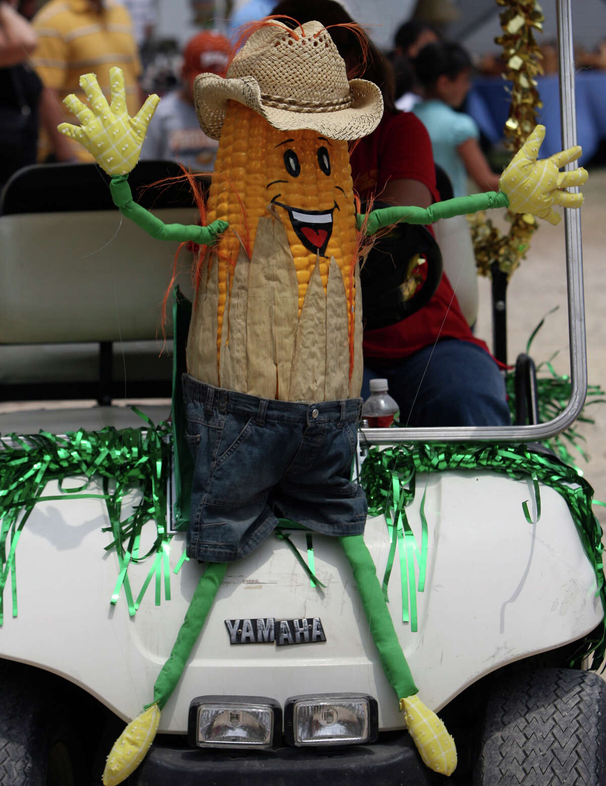 In this 2008 file photo, aCornyval Festival worker drives a golf cart with a large corn character mounted on the front. After the annual event was canceled in 2020 in response to the coronavirus pandemic, it is set to return next month.
