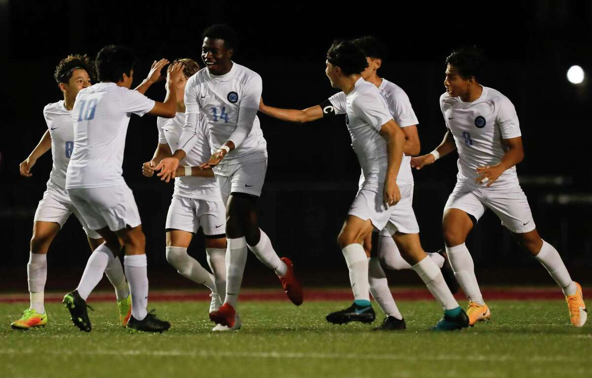 Katy Paetow's Toheeb Oladipupo (14) reacts after his second-period goal broke a 1-1 tie of a District 19-5A high school soccer match at Magnolia West High School, Wednesday, March 10, 2021, in Magnolia. Katy Paetow defeated Magnolia Wst 2-1.