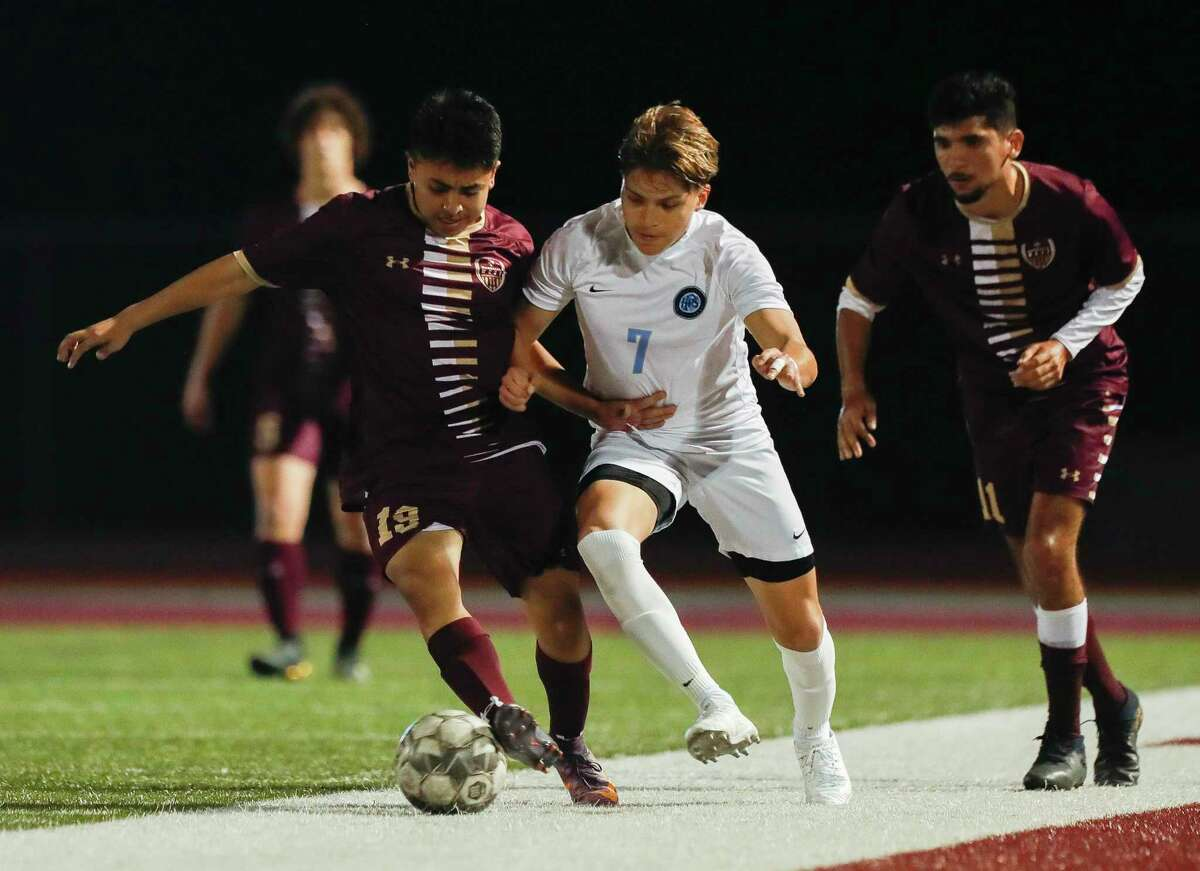 Magnolia West's Hector Chaparro (19) battles for the ball agaisnt Katy Paetow's Damian Soto (7) during the first period of a District 19-5A high school soccer match at Magnolia West High School, Wednesday, March 10, 2021, in Magnolia.