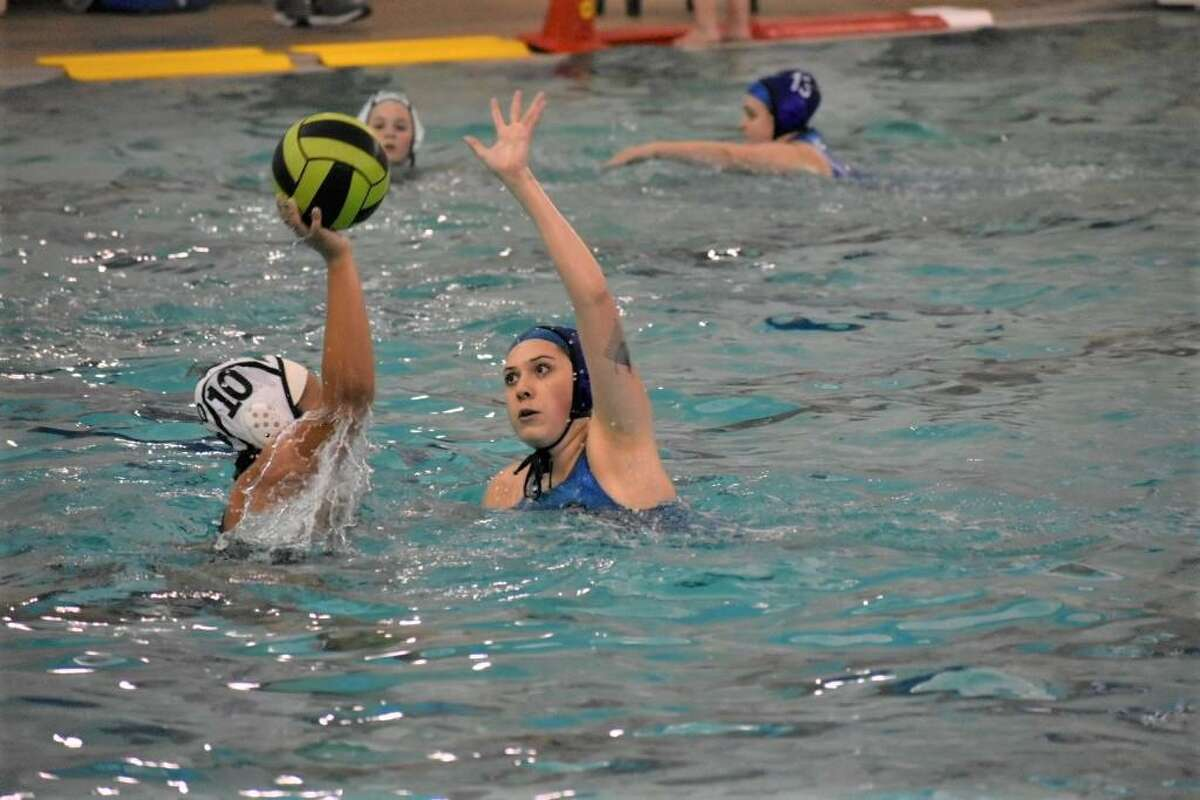 Friendswood's Mia Escobedo defends in a recent water polo match against Clear Falls. Friendswood won, 11-4.