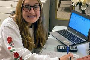 Liberty Middle School student Alayna Garman completes her classwork at home.