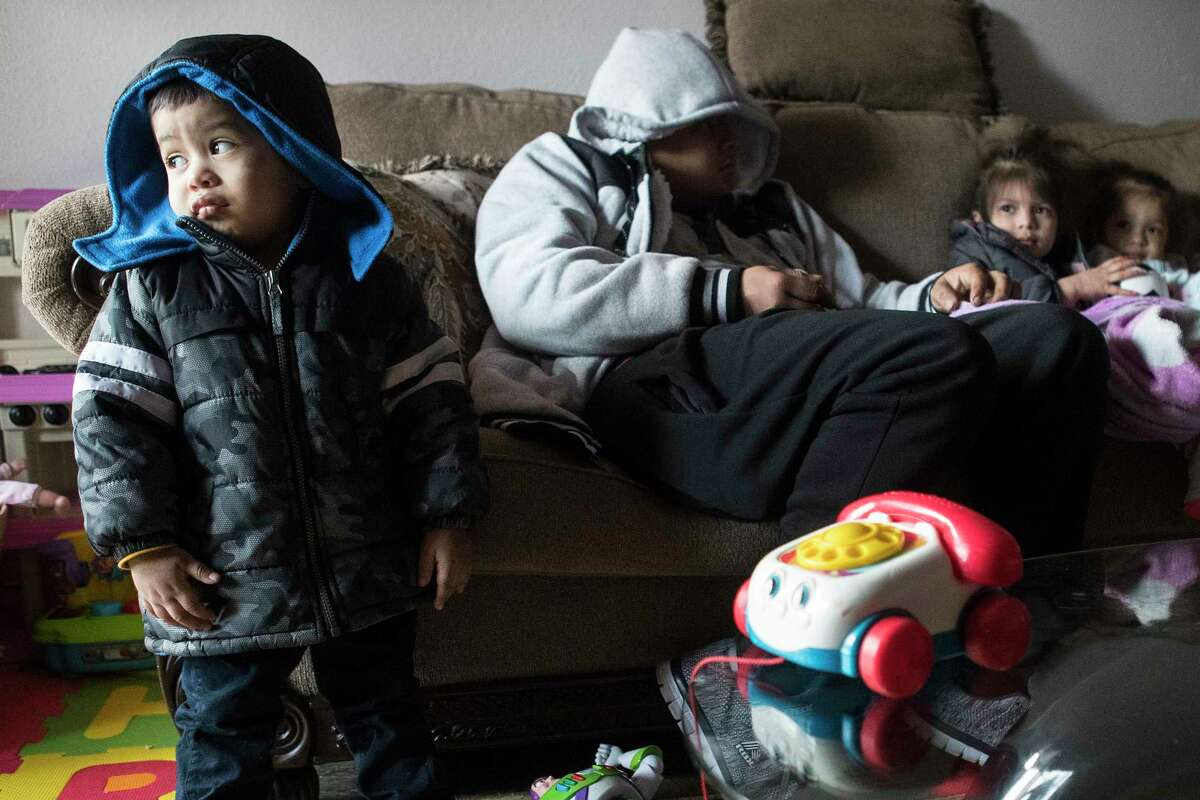 Eithan Colindres wears a winter coat inside after the apartment his family lives in the Greenspoint area that lost power following an overnight snowfall Monday, Feb. 15, 2021 in Houston. Temperatures plunged into the teens Monday with light snow and freezing rain.