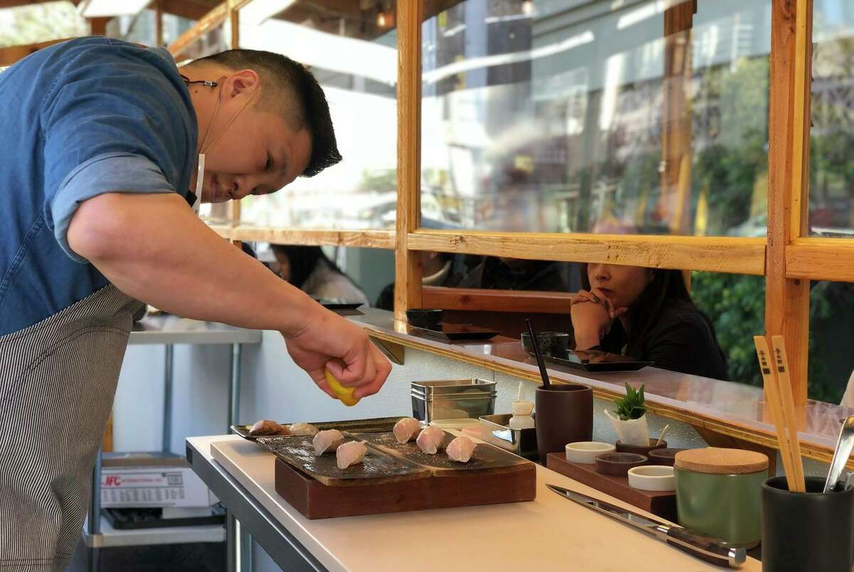 Executive chef Geoffrey Lee prepares sushi for a new all-outdoor omakase experience at Ju-Ni in San Francisco.
