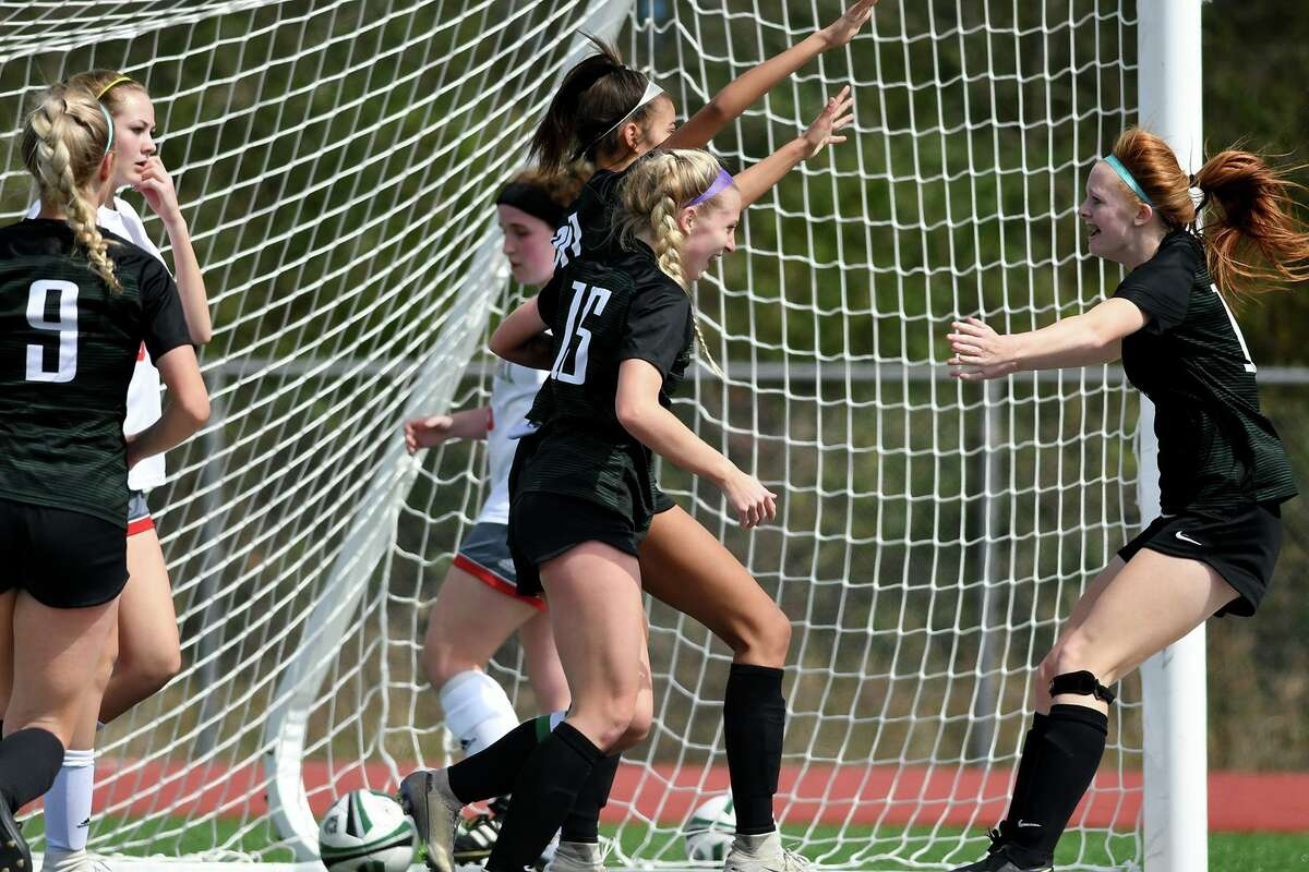 Kingwood Park freshman forward Emma Yeager, right, celebrates her assist on the Lady Panther's goal with teammates Mia Wehby (center top), who scored the goal, and Brooke Baldon (15) during their District 20-5A matchup with Tomball at KPHS on Feb. 29, 2020.