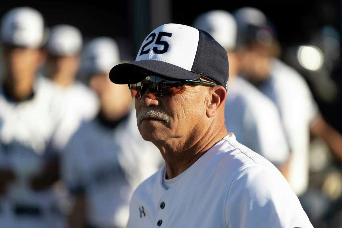 """Gary Hammond, assistant baseball coach at Concordia Lutheran High School, wears a #25 hat in honor of his colleague during a tribute in honor of baseball coach Rick Lynch, Thursday, March 25, 2021, in Tomball. School officials announced during the tribute that the field is officially named """"Rick Lynch Field."""""""