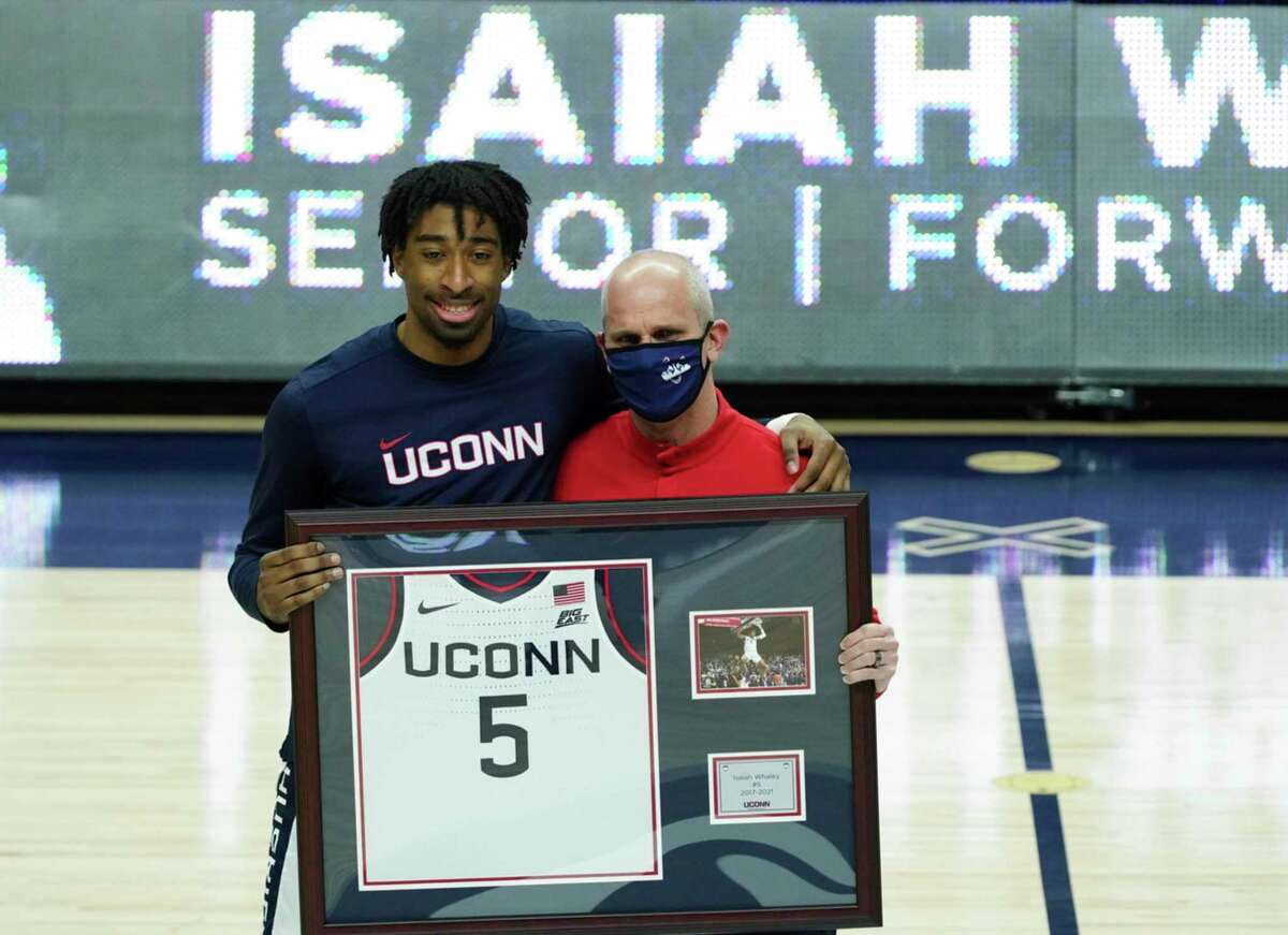 Connecticut forward Isaiah Whaley (5), left, with head coach Dan Hurley, is recognized during senior day before an NCAA college basketball game against Georgetown, Saturday, March 6, 2021, at Harry A. Gampel Pavilion in Storrs, Conn. (David Butler II/Pool Photo via AP)
