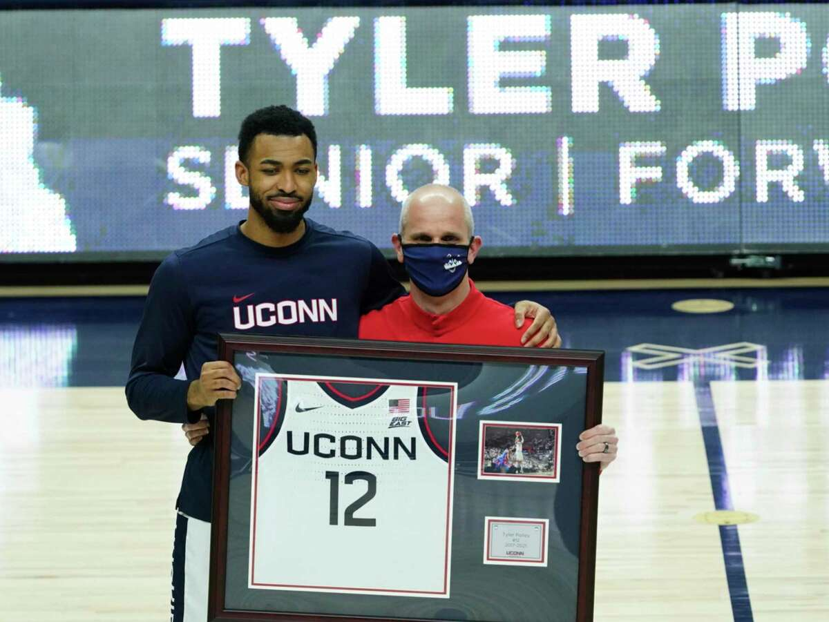 Connecticut forward Tyler Polley (12), left, with head coach Dan Hurley, is recognized during senior day before an NCAA college basketball game against Georgetown, Saturday, March 6, 2021, at Harry A. Gampel Pavilion in Storrs, Conn. (David Butler II/Pool Photo via AP)