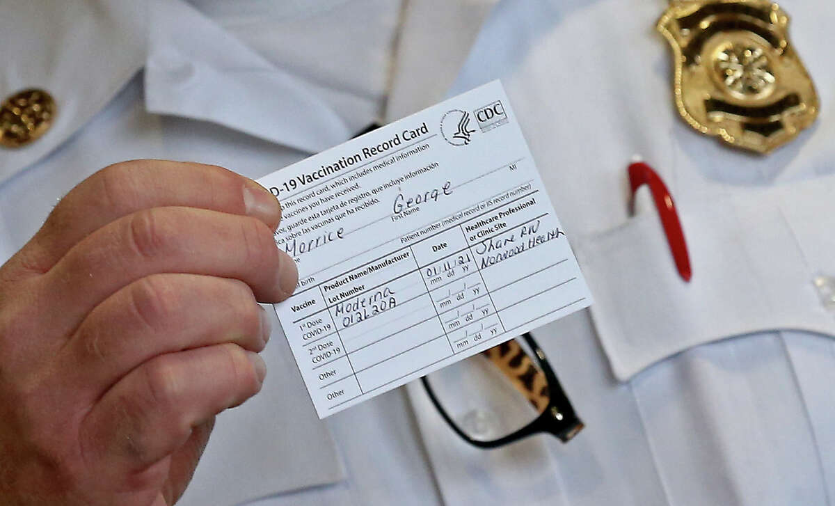 Norwood, MA. - January 11: Norwood Fire Chief George Morrice holds a vaccination card after receiving a COVID-19 vaccine on January 11, 2021 in Norwood, Massachusetts. (Staff Photo By Matt Stone/ MediaNews Group/Boston Herald)