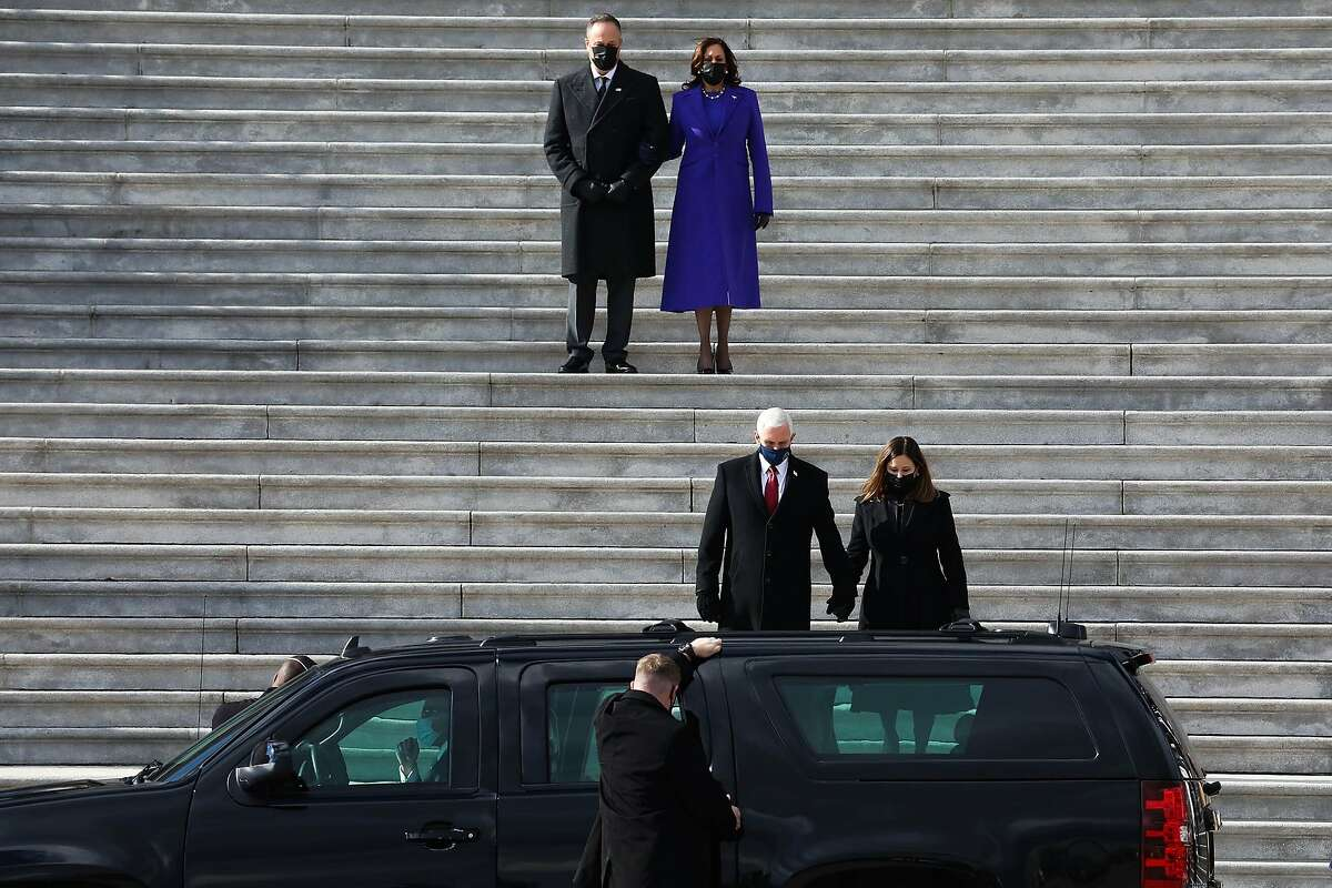 Second gentleman Doug Emhoff and Vice President Kamala Harris watch former Vice President Mike Pence and his wife, Karen, depart on Inauguration Day.