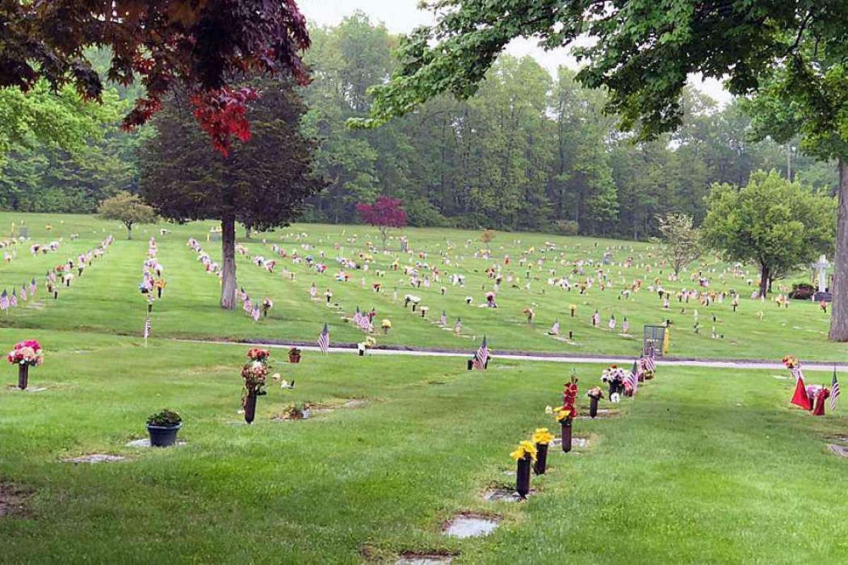 Members of several first responder agencies and the police departments cadet program in Trumbull, Conn., placed flags on thousands of graves on May 22, 2018.