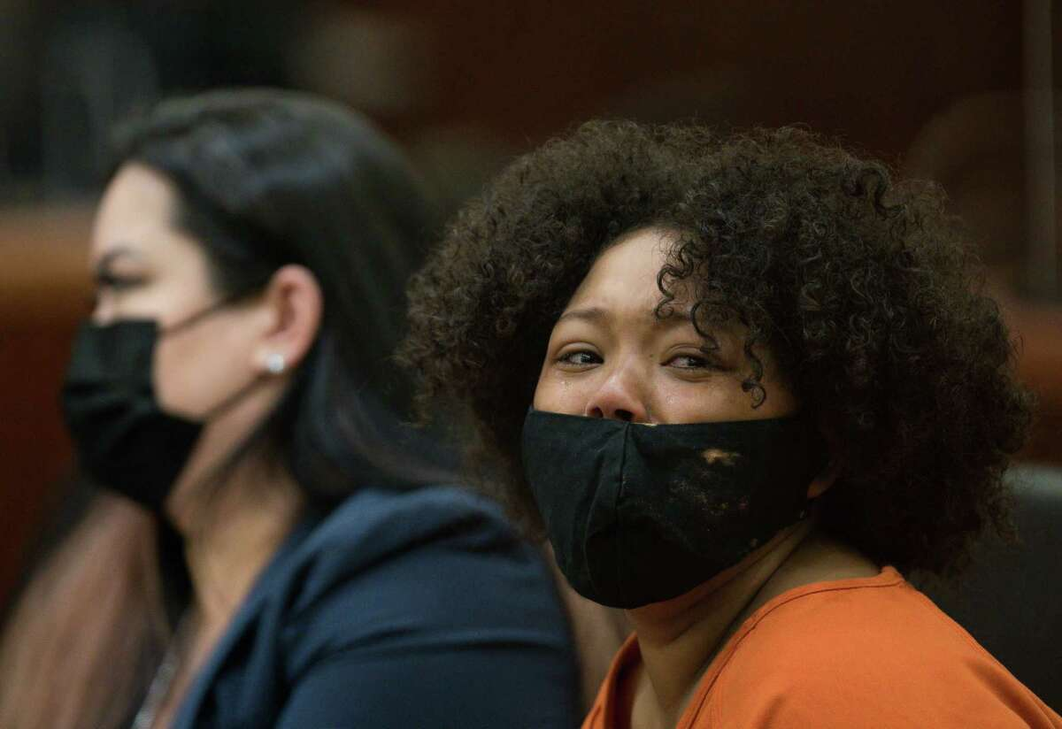 Kayla Holzendorf makes her initial court appearance before Judge Hilary Unger in the 248th Criminal Court on Friday, March 26, 2021, in Houston. Holzendorf is being charged with injury to a child and tampering with evidence in connection to the death of her son, 8-year-old Keyontae Holzendorf.