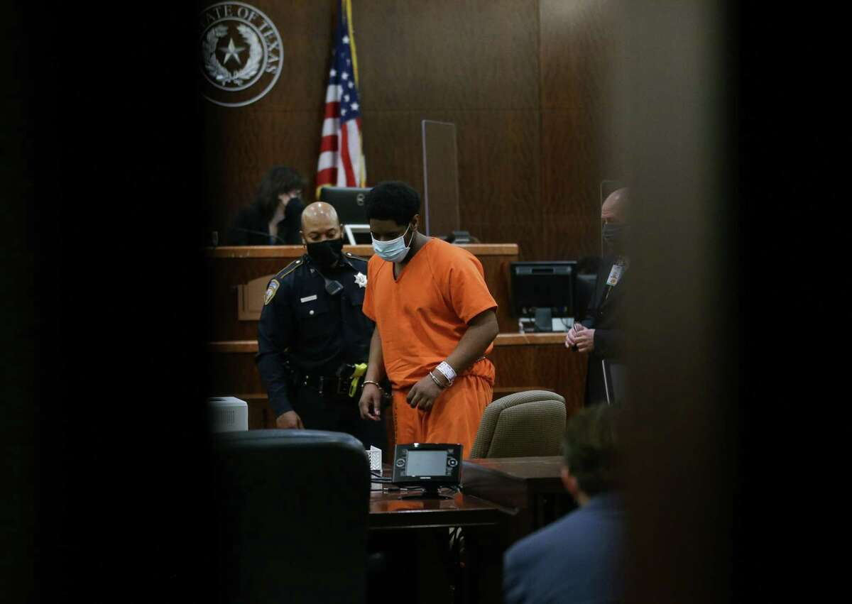 Dominique Lewis makes his initial court appearance before Judge Hilary Unger in the 248th Criminal Court on Friday, March 26, 2021, in Houston. Lewis and his common-law wife Kayla Holzendorf are being charged with injury to a child and tampering with evidence in connection to the death 8-year-old Keyontae Holzendorf.