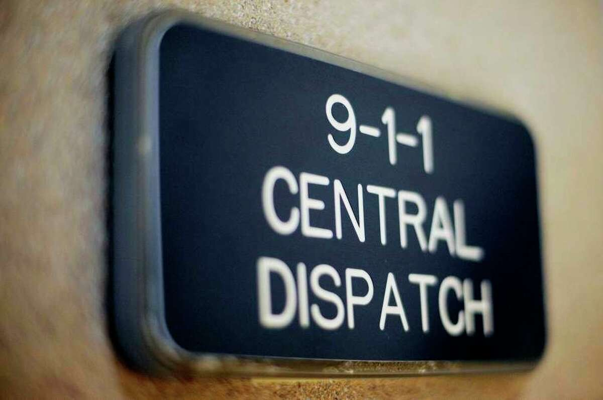 FILE -- A sign at the entrance to the Midland Central Dispatch Authority office in the Law Enforcement Center. (Nick King/Midland Daily News file)