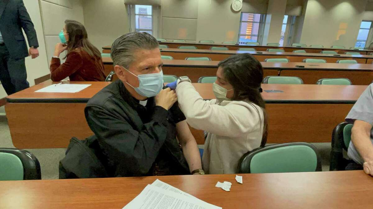 San Antonio Archbishop Gustavo García-Siller receives his first dose of the Moderna vaccine in January. Faith leaders can play a huge part in helping people overcoming vaccine hesitancy