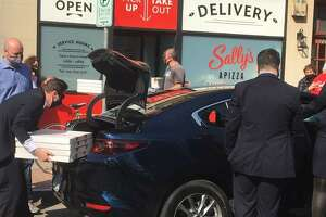 Pizzas are picked up from Sally's Apizza in New Haven Friday for Vice President Kamala Harris and her entourage.