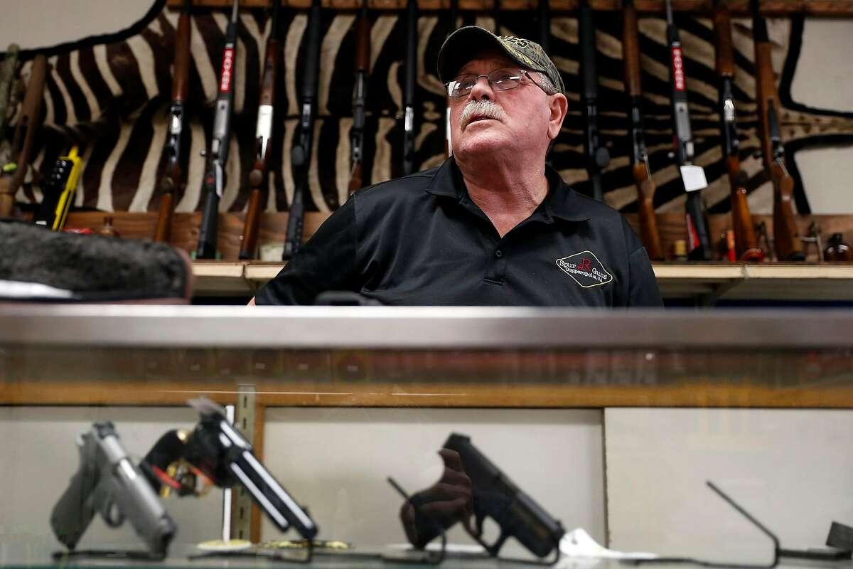 "Spur R Guns' owner Doug Rockey in Copperopolis (Calaveras County) says he considers Gov. Gavin Newsom a ""dictator."""
